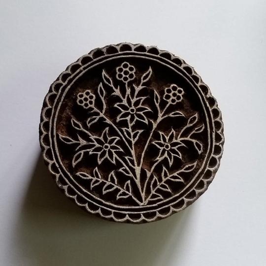 round floral stamp